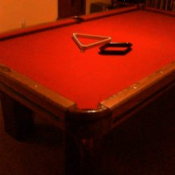 Pool Table with pool cues, chalk